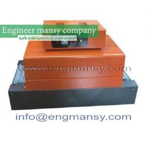 Conveyor belt shrink machine